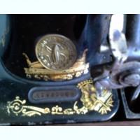 Антикварная швейная машинка SINGER